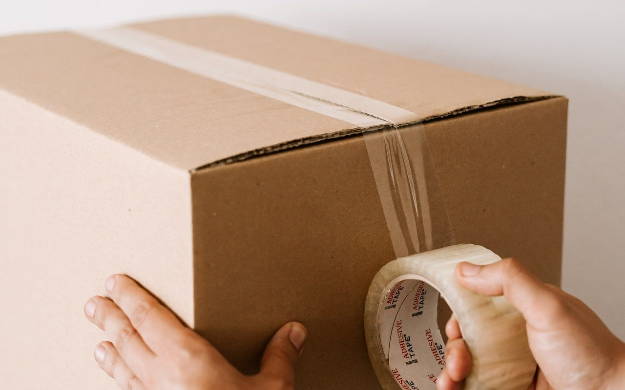 A box being prepped to move belongings.