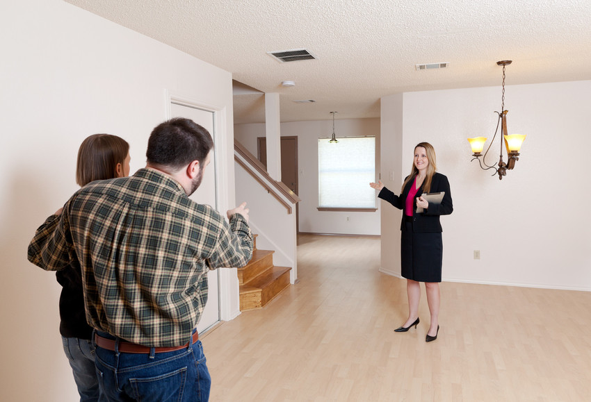 an agent showing a home while social distancing