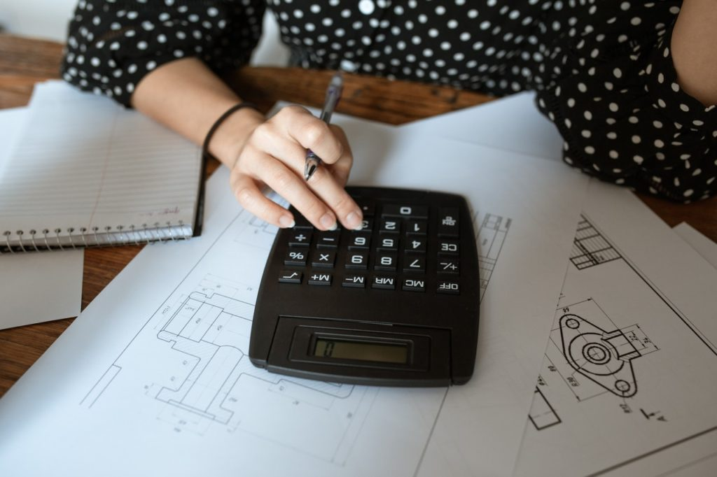 A woman going over calculations during the recession.